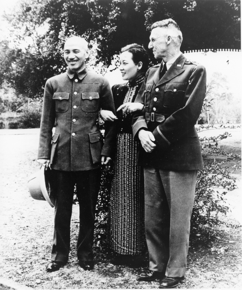 Chiang Kai-shek, Madame Chiang, and General Joseph Stilwell pose for the newsmen in 1942. (National Archives)